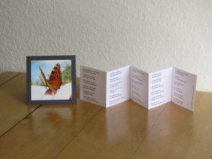 Aufgestellte Fotokarte mit Leporello